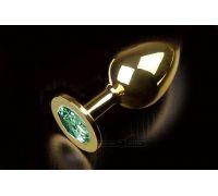 Большая золотистая анальная пробка с закругленным кончиком и кристаллом Пикантные Штучки, 9х3,5 см (зеленый)